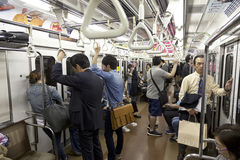 TOKYO- CIRCA MAY, 2016: Passengers traveling by Tokyo metro. Business people commuting to work by public transport in rush hour. S Stock Photo