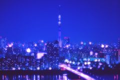 Tokyo city night background with blur bokeh lights. Nightlife Background in Tokyo. Tokyo Skyline with Blur Bokeh Lights Decoration in Colorful Filter. Tokyo Sky Stock Photography