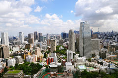 Tokyo city summertime. Shot from high up a view over the huge city of Tokyo, it's surrounded by highways, cars life, experience, Parks, buildings, businesses Stock Photos