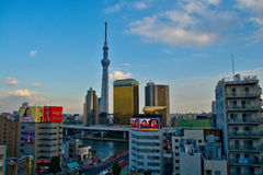 Tokyo city view from Asakusa. With Tokyo Sky Tree,  Asahi Beer Hall and some advertisements Royalty Free Stock Image
