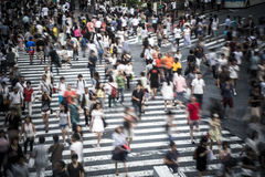 Tokyo crowd. Motion blur on large crowd at the famous Shibuya Crossing in the Japanese capital Stock Photo