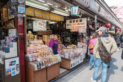 Tokyo crowds browsing in colourful Nakamise-dori market Senso-ji. Tokyo, Japan - Nov 30, 2015: Crowds of visitors browsing the colourful market stalls of Stock Photos
