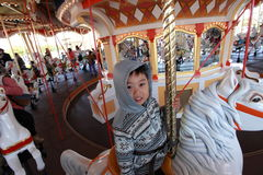 Tokyo Disneyland,Japan. Kid playing the magical carousel in Tokyo Disney,Japan stock photos