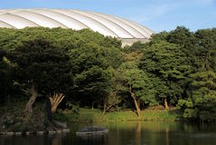 Tokyo Dome Garden contrast. The air-supported roof of the Tokyo Dome (The Big Egg) baseball stadium, homefield of the Yomiuri Giants team from the traditional stock photo