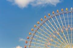 Tokyo giant ferris wheel against blue sky. Background Stock Photo