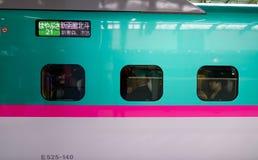 Shinkansen train stopping at station stock photos