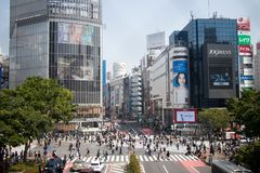 TOKYO, JAPAN - April 29, 2017: Pedestrians walk at Shibuya Cross. Ing, Tokyo. This five direction crosswalk is one of the busiest and largest of the world Royalty Free Stock Image
