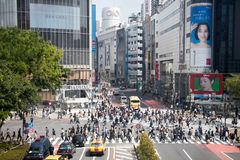 TOKYO, JAPAN - April 29, 2017: Pedestrians walk at Shibuya Cross. Ing, Tokyo. This five direction crosswalk is one of the busiest and largest of the world Stock Photos