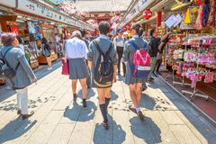 Nakamise Dori Senso-ji. Tokyo, Japan - April 19, 2017: people in school uniforms walking on Nakamise Dori, street with food and souvenirs shops. Kaminarimon Gate Royalty Free Stock Photography