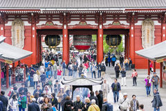 Tokyo, Japan - April 21, 2014: People visiting Sensoji Temple in Asakusa district in Tokyo. Sensoji is Tokyo's oldest temple. Royalty Free Stock Photos