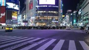 Road traffic at Shibuya pedestrian scramble at night, Tokyo, Japan stock footage