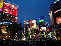 Tokyo, Japan - April 4, 2016 :Shibuya crossing at night with col. Tokyo, Japan - April 4, 2016 :Shibuya crossing crowded at night with colorful light signage and Royalty Free Stock Images
