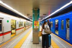 People travel through tokyo subway system. Tokyo, Japan - April 20 2018: Unidentified people travel through tokyo subway system royalty free stock photo