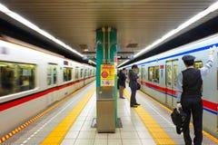 Unidentified people travel through tokyo subway system. Tokyo, Japan - April 20 2018: Unidentified people travel through tokyo subway system stock photos