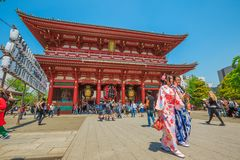Kimono women at Sensoji Temple. Tokyo, Japan - April 19, 2017: young women in traditional japanese kimonos coming out of the Hozomon, Treasure-House Gate Royalty Free Stock Images