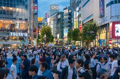 Crowd of people on famous Shibuya pedestrian crossing at night Stock Photo