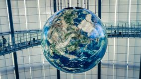 Tokyo, Japan - August 2018: A giant globe with interactive projections inside National Museum of Emerging Science and Innovation, royalty free stock image