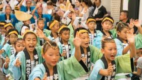 Japanese children dancing traditional Awaodori dance in the famous Koenji Awa Odori festival, Tokyo, Japan royalty free stock image