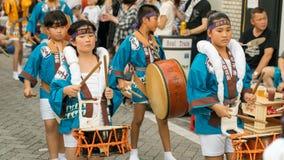 Japanese children dancing traditional Awaodori dance in the famous Koenji Awa Odori festival, Tokyo, Japan royalty free stock images