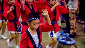 Japanese children dancing traditional Awaodori dance in the famous Koenji Awa Odori festival, Tokyo, Japan royalty free stock photo