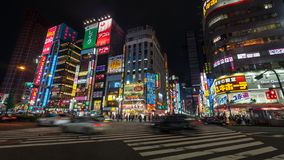 Long exposure photo of people at Kabukicho in the Shinjuku, an entertainment and red-light district, Tokyo, Japan. Tokyo, Japan - August 2018: Long exposure stock image