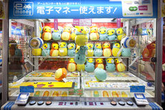 TOKYO,JAPAN- CIRKA MAY, 2016: Toy crane game vending machine at game center in Tokyo. Japan. Toy crane game vending machine at game center in Tokyo. Japan Stock Photo