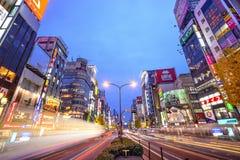 Tokyo, Japan Cityscape in Kabuki-cho District. TOKYO, JAPAN - DECEMBER 15, 2012: Traffic passes through Shinjuku at Kabuki-cho. The area is a famed nightlife Stock Images