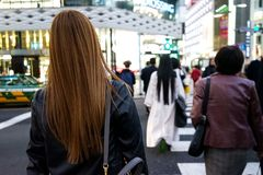 Tokyo, Japan 10.02.2018 crowd of citizens and tourists in business and casual clothes crossing street in popular Ginza district of stock photo