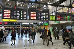 Tokyo Shinagawa Station. TOKYO, JAPAN - DECEMBER 3, 2016: Passengers hurry in Shinagawa Station in Tokyo. The station was used by 335,661 passengers daily in Royalty Free Stock Photos