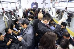 Crowded metro in Tokyo stock photography