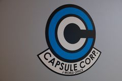 Capsule Corp logo of Dragon Ball super in a wall on J-World theme park in Toshima district. TOKYO, JAPAN - 23 FEB 2018: Capsule Corp logo of Dragon Ball super in royalty free stock photos