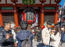 Crowd of tourists by giant red lantern in Kaminarimon Gate of Senso-ji Temple in Asakusa area. It is also known as Thunder Gate royalty free stock photography