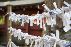 TOKYO, JAPAN - FEBRUARY 17, 2016 : Omikuji :: random fortune pap Royalty Free Stock Photos