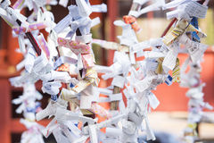 TOKYO, JAPAN - FEBRUARY 17, 2016 : Omikuji :: random fortune pap Royalty Free Stock Images