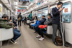 TOKYO, JAPAN - FEBRUARY 5, 2019: Tokyo Public Transport Train with Passangers. Metro Line. Japan. Tokyo Public Transport Train with Passangers. Metro Line royalty free stock photography