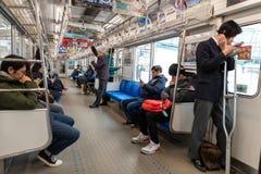 TOKYO, JAPAN - FEBRUARY 5, 2019: Tokyo Public Transport Train with Passangers. Metro Line. Japan. Tokyo Public Transport Train with Passangers. Metro Line stock images