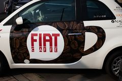 Tokyo, Japan: Fiat Alfa Romeo center - Fiat Chrysler Automobiles NV FCA with cafe royalty free stock photography