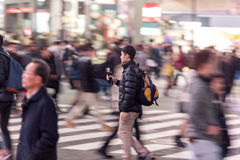 TOKYO, JAPAN - JANUARY 28, 2017: Shibuya District in Tokyo. Famous and busiest intersection in the world, Japan. Shibuya Crossing. Shibuya District in Tokyo Royalty Free Stock Image