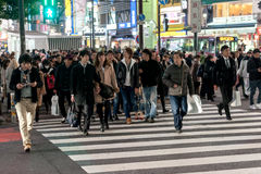 TOKYO, JAPAN - JANUARY 28, 2017: Shibuya District in Tokyo. Famous and busiest intersection in the world, Japan. Shibuya Crossing. Royalty Free Stock Images