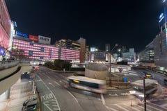 TOKYO, JAPAN - JANUARY 26, 2017: Tokyo Shinjuku Station. Evening Long Exposure Street Photo. Blurry Traffic Stock Image