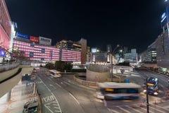 TOKYO, JAPAN - JANUARY 26, 2017: Tokyo Shinjuku Station. Evening Long Exposure Street Photo. Blurry Traffic Stock Photo
