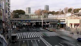 Tokyo,Japan-January 20, 2014:The traffic in front of Ueno Station and cloud moving, time lapse video stock footage