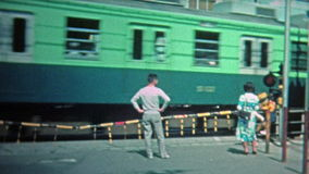 TOKYO, JAPAN -1972: Japanese train station and passing train scenes. stock video footage