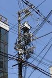 Tokyo Japan - japansk elektricitetspylon Royaltyfri Foto