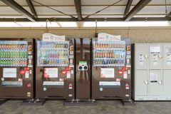 Tokyo, JAPAN - July 2018: Automatic soft drinks dispenser with banner promote olympic 2020 in Japan stock image