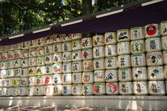 TOKYO JAPAN July 27, 2016: Japanese Sake barrels stacked at the entrance of Meiji shrine at Tokyo, Japan Royalty Free Stock Images