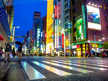 TOKYO, JAPAN -28 JUN 2017: Unidentified people Crossing the street through zebra in the Electrical Town of Akihabara, in Royalty Free Stock Image