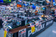 TOKYO, JAPAN JUNE 28 - 2017: Assorted cameras and lenses inside of Yodobashi camera department store. Yodobashi Camera Royalty Free Stock Photo