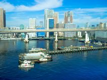 TOKYO, JAPAN JUNE 28 - 2017: Beautiful view of some boats parked in a pier, in a beautiful sunny day with a blue sky in Stock Image