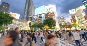 TOKYO, JAPAN - JUNE 1, 2016: Buildings and ads with tourists in. TOKYO, JAPAN - JUNE 1, 2016: Buildings and ads in Shibuya. Tokyo attracts 20 million tourists royalty free stock photos